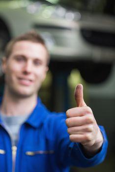 Repairman gesturing thumbs up