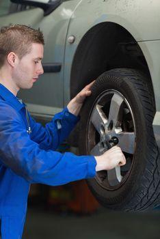 Mechanic changing car tyre