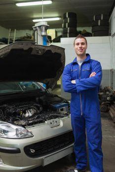 Happy mechanic by breakdown car