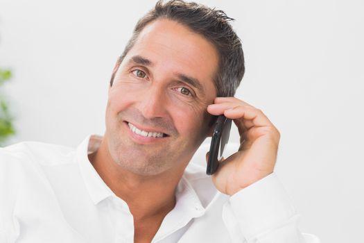 Smiling man phoning