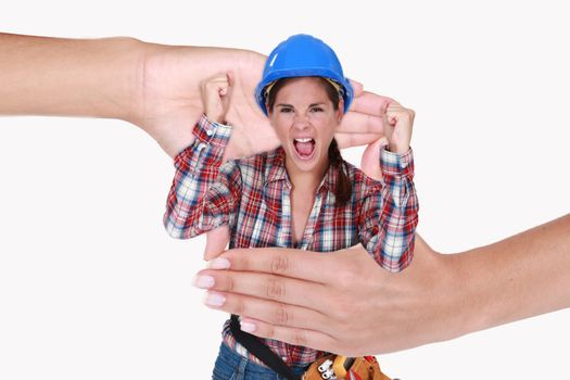 Montage of a screaming woman laborer