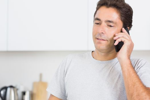 Man phoning in kitchen