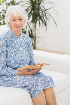 Elderly woman reading a old novel