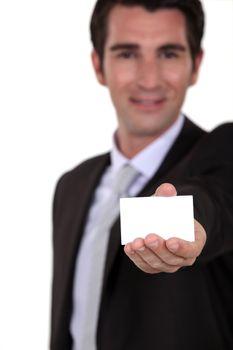 Businessman holding calling card