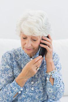 Aged woman phoning