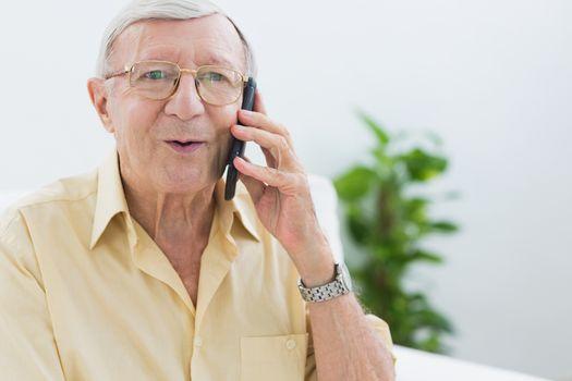 Elderly man phoning