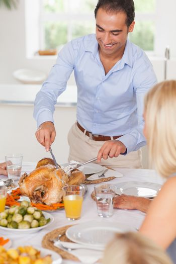 Man standing to carve the turkey