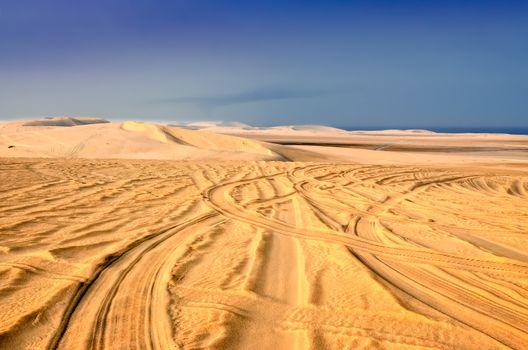 Tyre tracks in sand desert