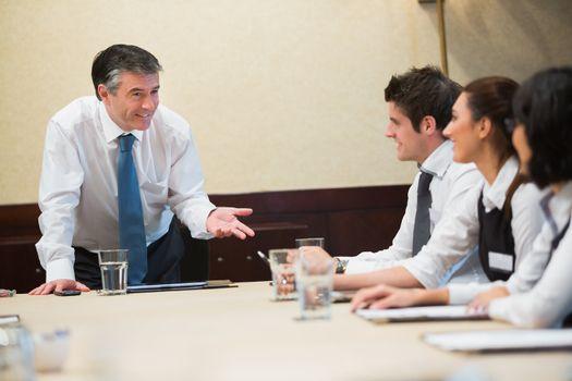 Smiling boss at meeting