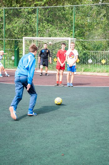 The city of Orenburg, Orenburg oblast, Russia, August 10, 2013.  The feast day of the athlete. Tournament on mini-football among school teams.
