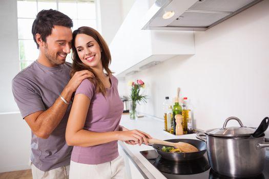 Woman preparing food at the stove