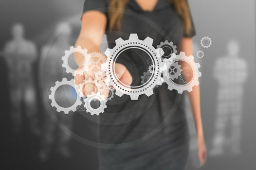 Busineswoman touching illustrated wheels and cogs