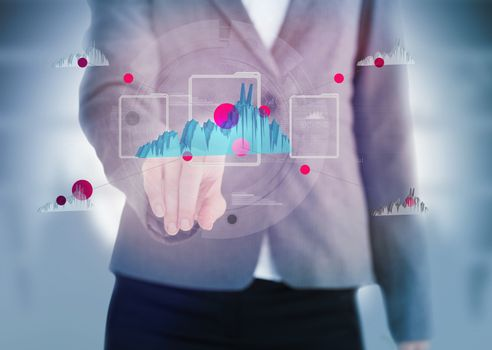 Businesswoman pointing to a graph on touchscreen