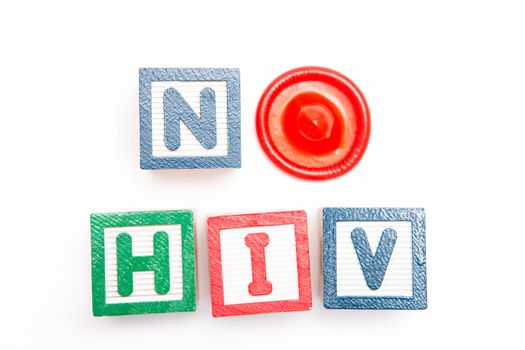 No Hiv spelled out in blocks and a condom