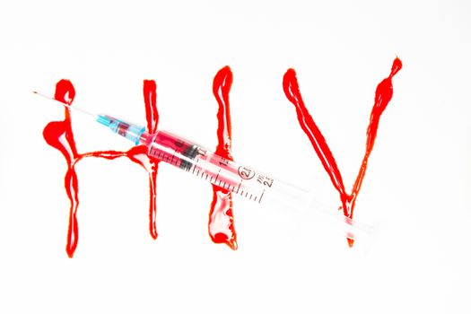HIV spelled out in blood and syringe