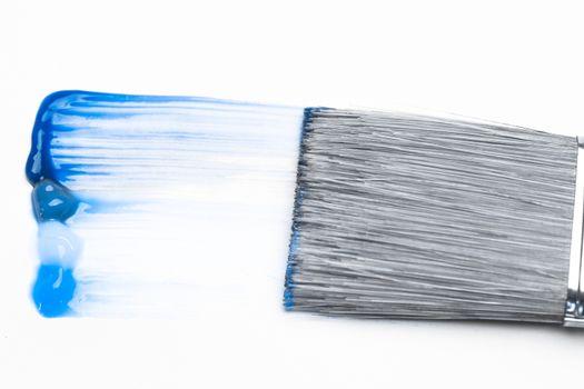 Paintbrush with blue brush stroke