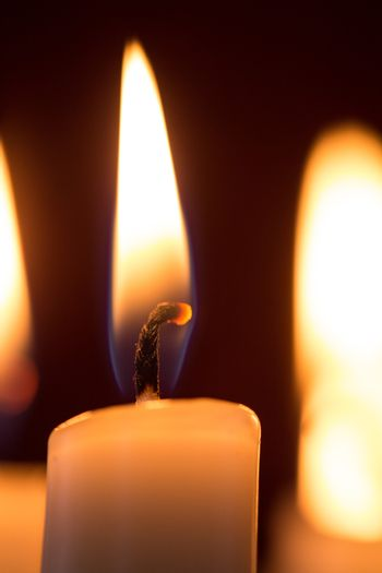 Close up of lit candle