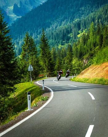 Group of motorcyclists in Alpine mountains
