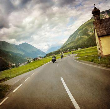 Biker race across mountainous village
