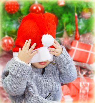 Naughty boy in Santa hat