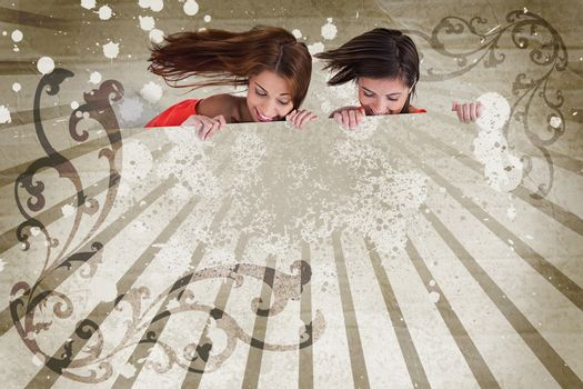 Girls looking down on copy space on art deco style background