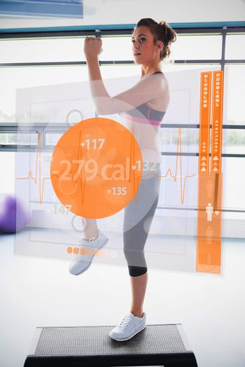 Woman doing exercise with futuristic interface showing calories