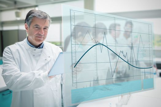 Confident scientist working with tablet and futuristic interface showing graph with curve and line