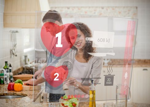 Happy couple making dinner using interface instructions