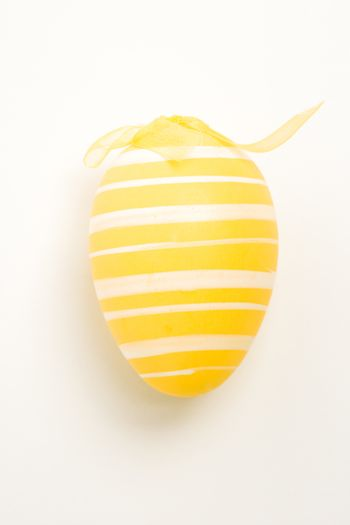 Yellow hand painted easter egg