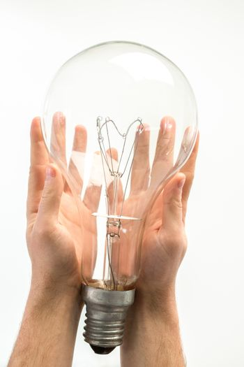 Man holding big light bulb in his hands