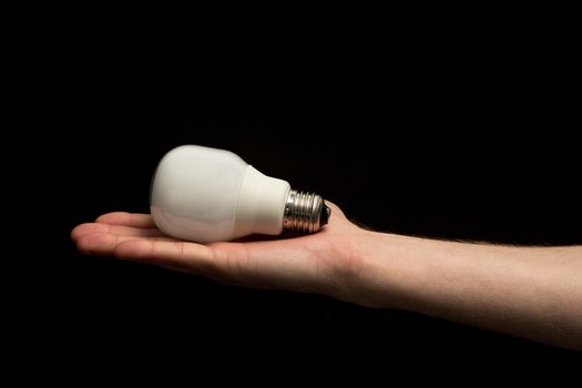 Hand holding economic light bulb
