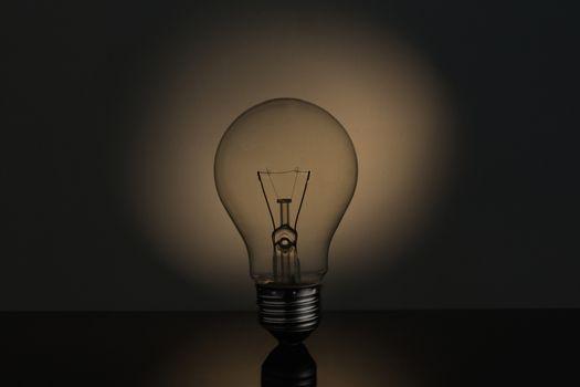 Big light bulb standing in sepia tones