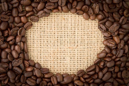 Coffee beans with oval indent for copy space