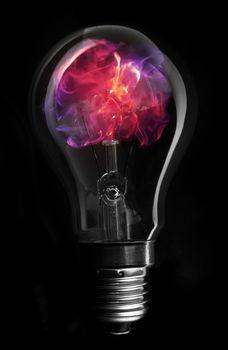 Pink flame inside light bulb