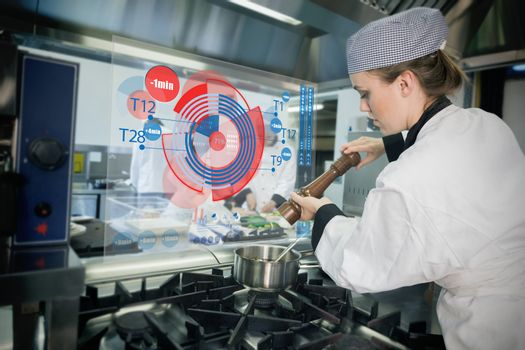 Chief preparing food while consulting futuristic interface