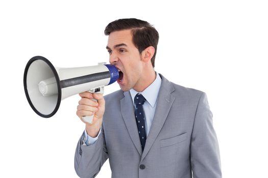 Businessman yelling into a megaphone