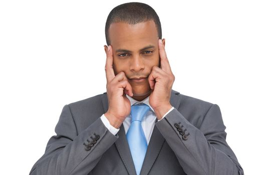 Businessman putting his fingers on his temples