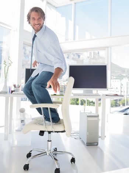 Man surfing his swivel chair