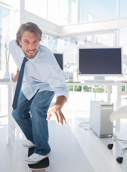 Employee skating through his office