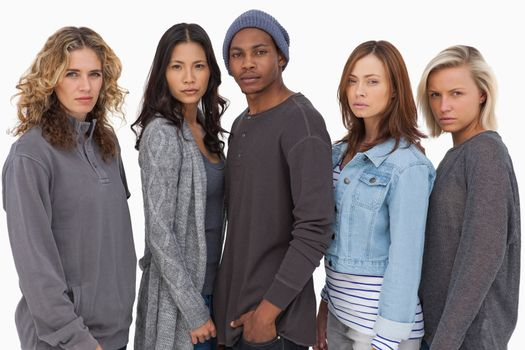 Fashionable young people in a row on white background