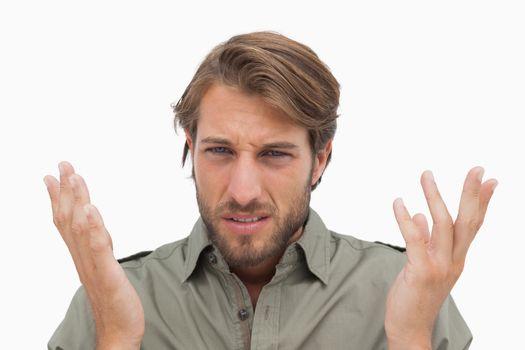 Irritated man gestuing at camera