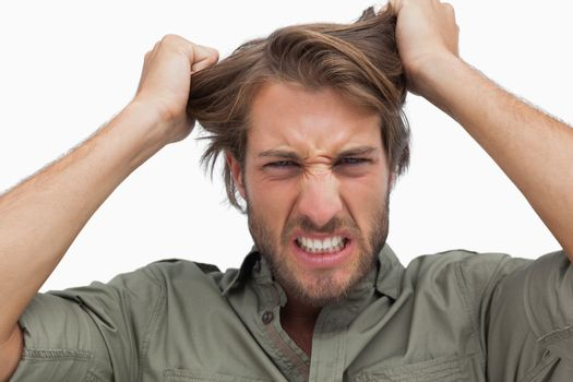 Furious man pulling his hair