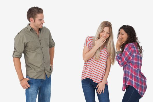 Girls laughing about secrets and leaving man out