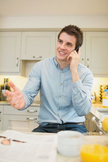 Man gesticulating while phoning