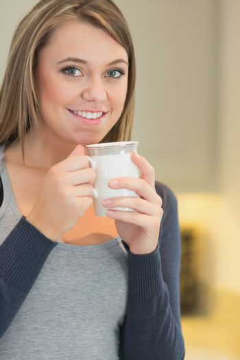 Woman warming up with a hot beverage