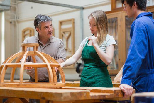 Teacher teaching a woodwork class