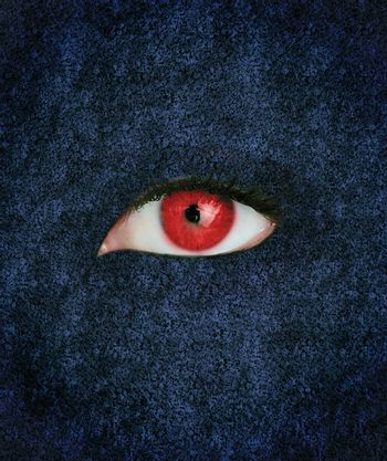 Red eye with eyelashes over blue texture