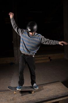 Skater doing manual trick on manual pad