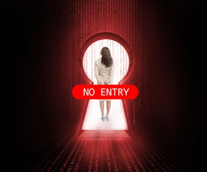 Doorway blocked by no entry sign with businesswoman