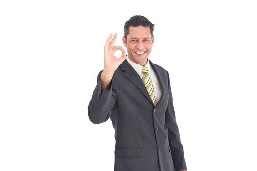 Smiling businessman saying ok